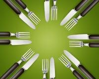 Lege exemplaar ruimtecirkel in reeks messen en vorken Stock Foto