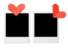 Lege fotoframes met origamiharten Stock Fotografie