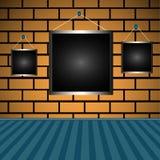 Lege frames op een bakstenen muur Royalty-vrije Stock Fotografie