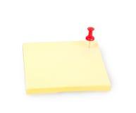 Lege gele kleverige nota met rode duwspeld Stock Foto