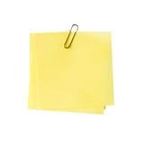 Lege gele nota en klem op geïsoleerd stock foto's