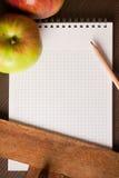 Lege handboek en appelen Stock Afbeelding