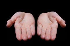 Lege handen op zwarte stock foto