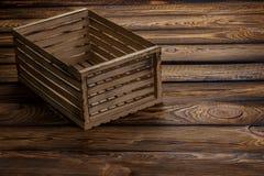 Lege houten doos op houten achtergrond royalty-vrije stock foto