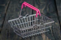 Lege Miniatuur het Winkelen Manden Stock Foto's