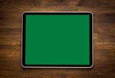 Lege moderne digitale tablet op een houten bureau bovenkant Stock Afbeeldingen