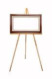 Lege omlijsting op houten schildersezel Royalty-vrije Stock Fotografie