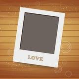 Lege onmiddellijke foto op houten achtergrond Stock Afbeeldingen