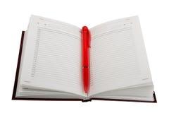Lege open agenda en rode balpen. royalty-vrije stock afbeelding