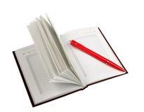 Lege open agenda en rode balpen royalty-vrije stock afbeeldingen