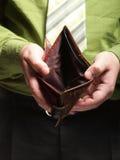 Lege portefeuille in mannelijke handen - slechte economie Royalty-vrije Stock Afbeeldingen