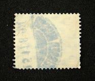 Lege postzegel met poststempel stock foto's