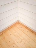 Lege ruimtehoek met houten vloer Stock Foto's