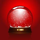 Lege snowglobe op rood Stock Foto's