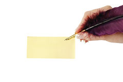 Lege visitekaartje en hand met veer Stock Foto