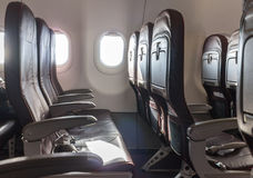 Lege vliegtuigzetels stock afbeeldingen