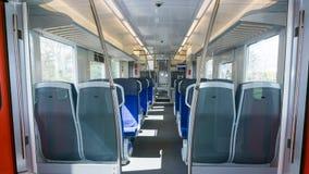 Lege Wagen binnen van treinachtergrond stock afbeelding