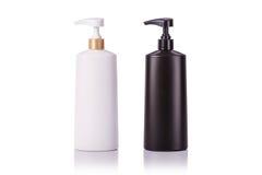 Lege witte en zwarte plastic die pompfles voor shampoo wordt gebruikt of zo Stock Afbeelding