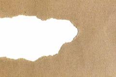 Lege witte ruimte in gescheurd pakpapier stock fotografie