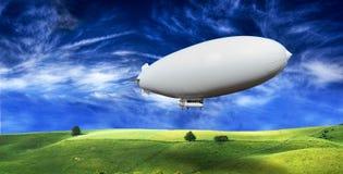 Lege zeppelin op beatifull groene weide royalty-vrije stock afbeeldingen