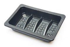 Lege zwarte plastic containers Stock Afbeeldingen