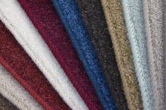 Legen Sie Proben mit Teppich aus Stockfotos