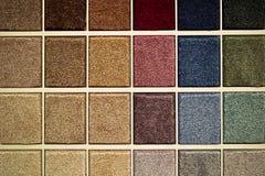Legen Sie Proben mit Teppich aus Stockbilder