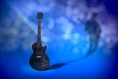Legend. A gibson les paul bfg electric guitar as it makes a shadow casting on the wall Stock Image