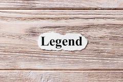 Legend av ordet på papper Begrepp Ord av legenden på en träbakgrund arkivfoto