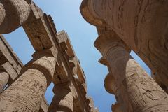 Legend of Egypt-Karnak Temple. This is a picture from Karnak Temple, the Towering pillar represents the great history of Egypt. The picture is taken at noon stock images