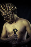 Legend, Warrior with helmet and sword with his body painted gold Royalty Free Stock Photography
