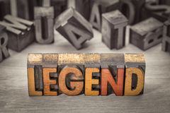 Legend word in letterpress wood type. Legend word abstract in vintage letterpress wood type printing blocks stained by color inks, color combined with black and stock image