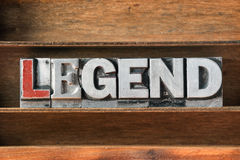 Legend word tray. Legend word made from metallic letterpress type on wooden tray royalty free stock photo