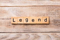 Legend word written on wood block. legend text on wooden table for your desing, concept royalty free stock photos