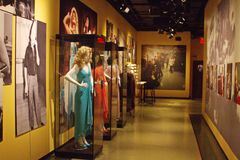 Legendary costumes on the set at SNL Exhibition in NYC. Well known actor`s costumes worn in classic performances while on Saturday Night Live. Memorabilia from Royalty Free Stock Photography