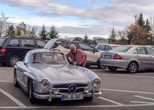 Legendary Gullwing Mercedes 300 SL sportcars to a road parking Stock Photos