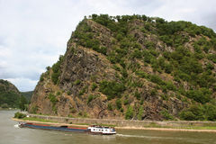 The legendary Loreley rock. With the River Rhine (Rhein) and a container ship in Germany royalty free stock images
