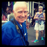 Legendary photographer Bill Cunningham at the LGBT Gay Pride March. NEW YORK CITY - JUNE 24:  Legendary photographer Bill Cunningham smiles at the annual LGBT Royalty Free Stock Photos