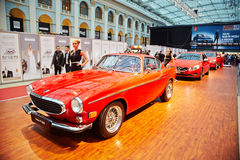 Legendary Volvo P1800, SUV XC60 and S60 sport sedan. MOSCOW - APR 4: Legendary Volvo P1800, SUV XC60 and S60 sport sedan at stand in Gostiny Dvor during Volvo royalty free stock image