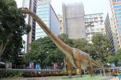 Legendas da exposição gigante dos dinossauros em Hong Kong Fotografia de Stock