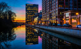 The Legg Mason Building reflecting in the water at twilight, in Stock Photos