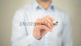 Legge ambientale, scrittura dell'uomo sullo schermo trasparente Fotografia Stock
