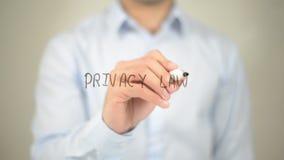 Legge di segretezza, scrittura dell'uomo sullo schermo trasparente Fotografie Stock