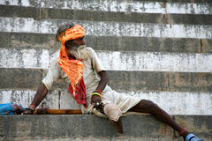 Legged old Sadhu standing up on the stairs of a ghat in Varanasi Stock Photography