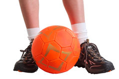 Leggs and orange ball Royalty Free Stock Photo