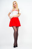 Leggy beautiful blonde girl posing Stock Photography