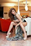 Leggy beautiful young woman. In a restaurant Royalty Free Stock Image