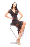 Leggy beauty in a high chair Stock Photo