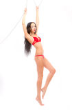 Leggy beauty in red underwear hanging Royalty Free Stock Photography