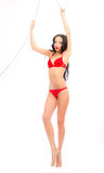 Leggy beauty in red underwear hanging Stock Photo